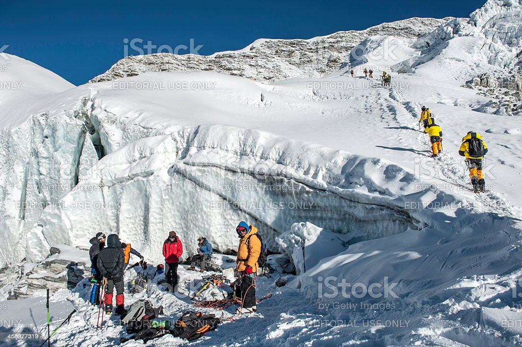 climbing in Himalayas stock photo