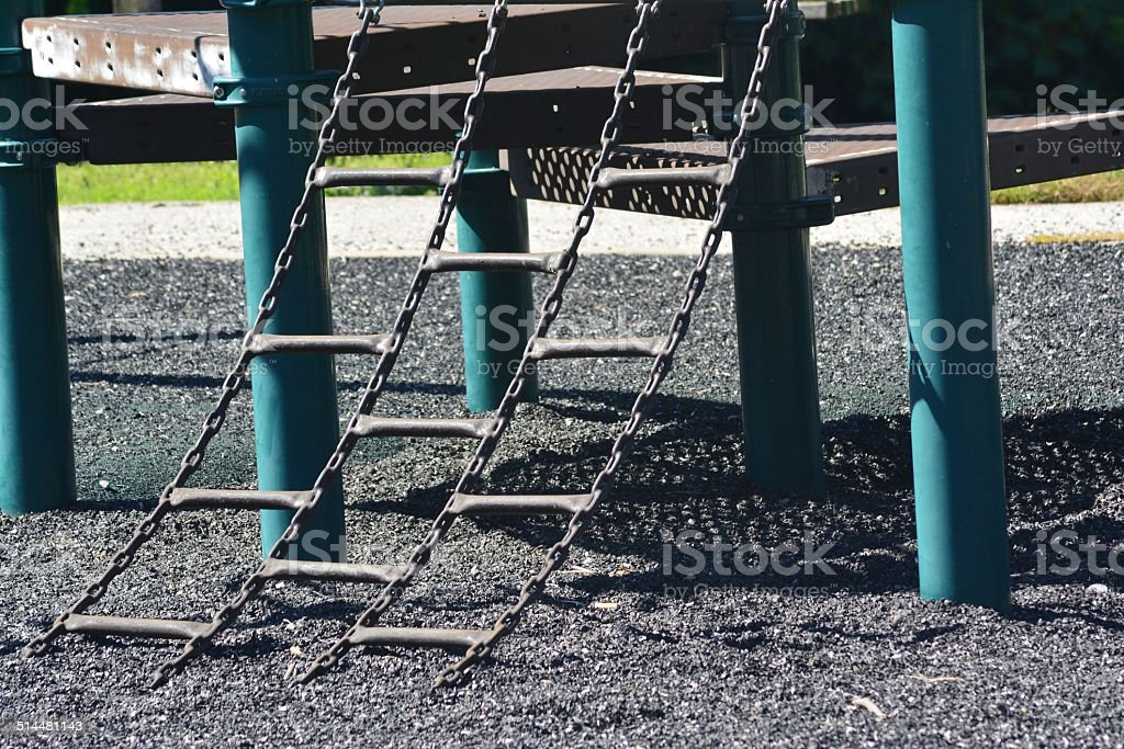 Climbing Ladder on a Jungle Gym stock photo