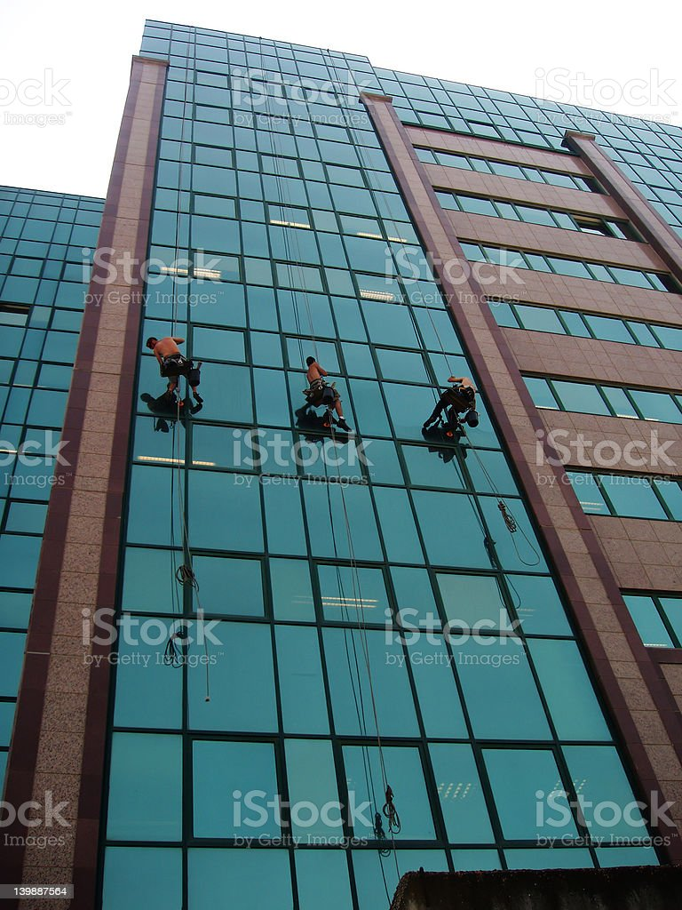 Climbing on a building stock photo