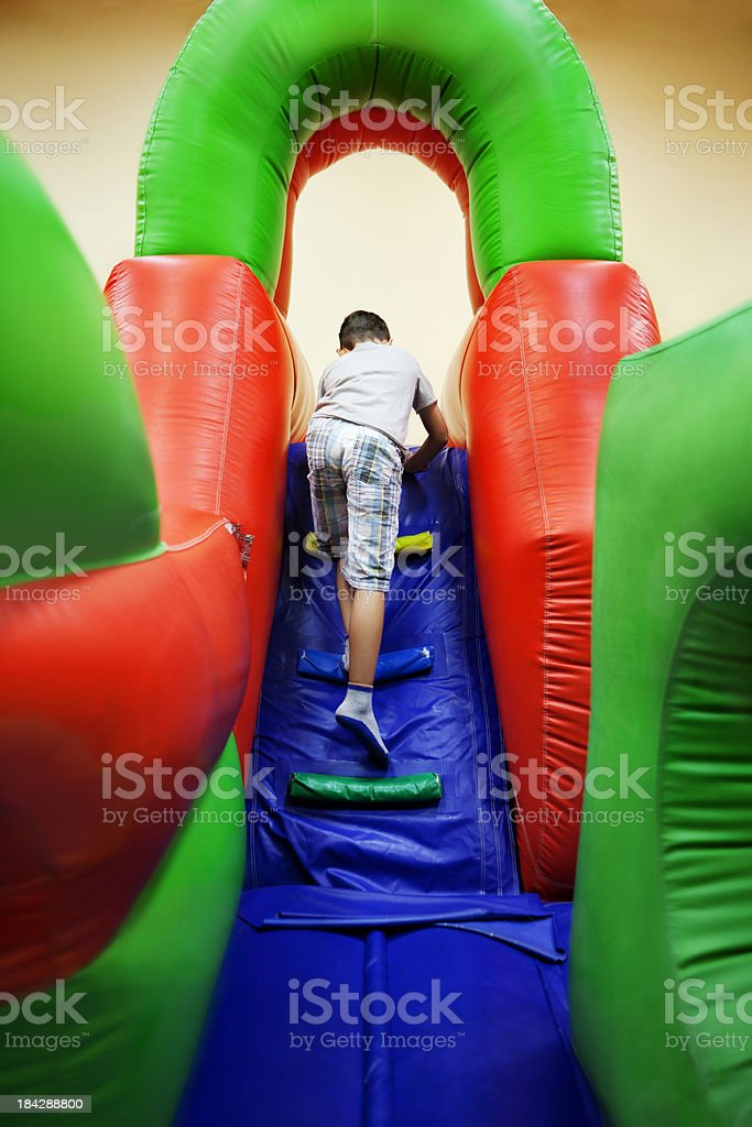Climbing on Inflatable Playground stock photo