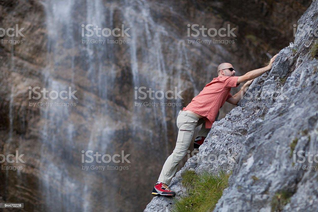 climbing on rock royalty-free stock photo