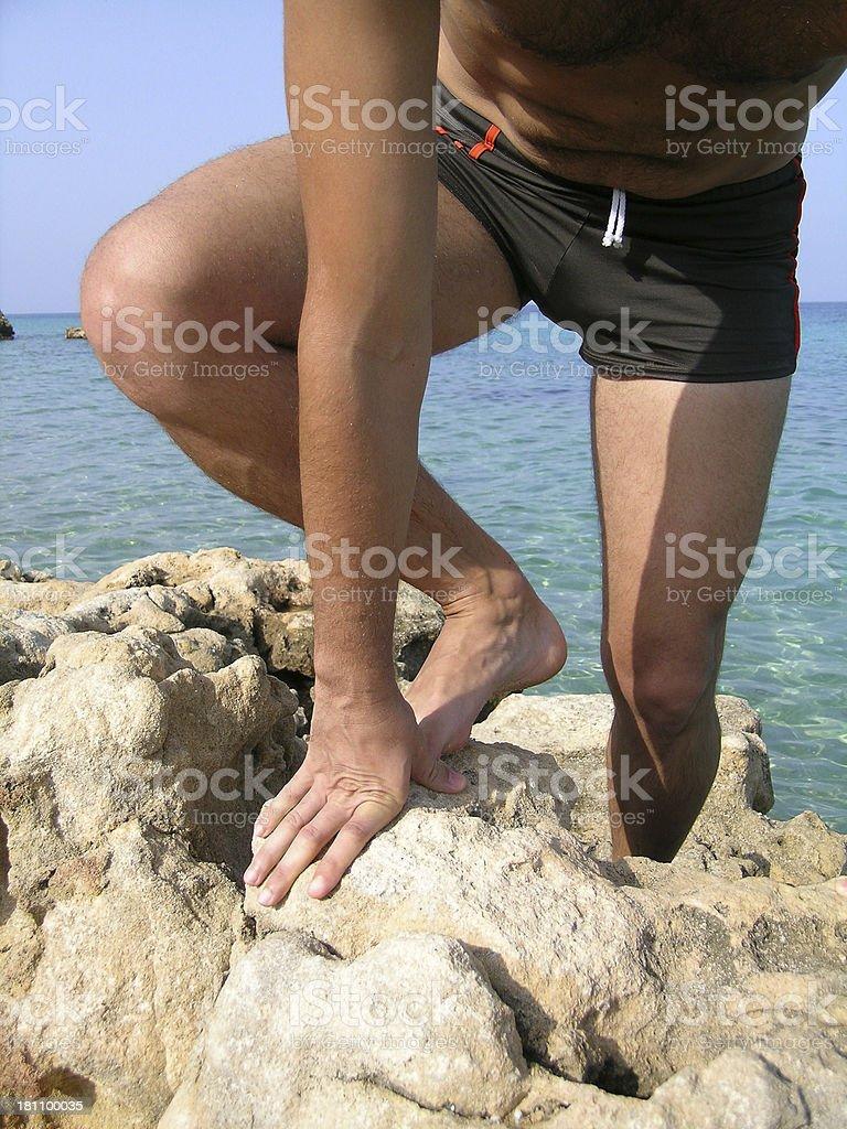 Climbing on rocks stock photo