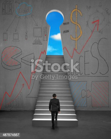 istock Climbing on stairs with business concept doodles on wall 487574557