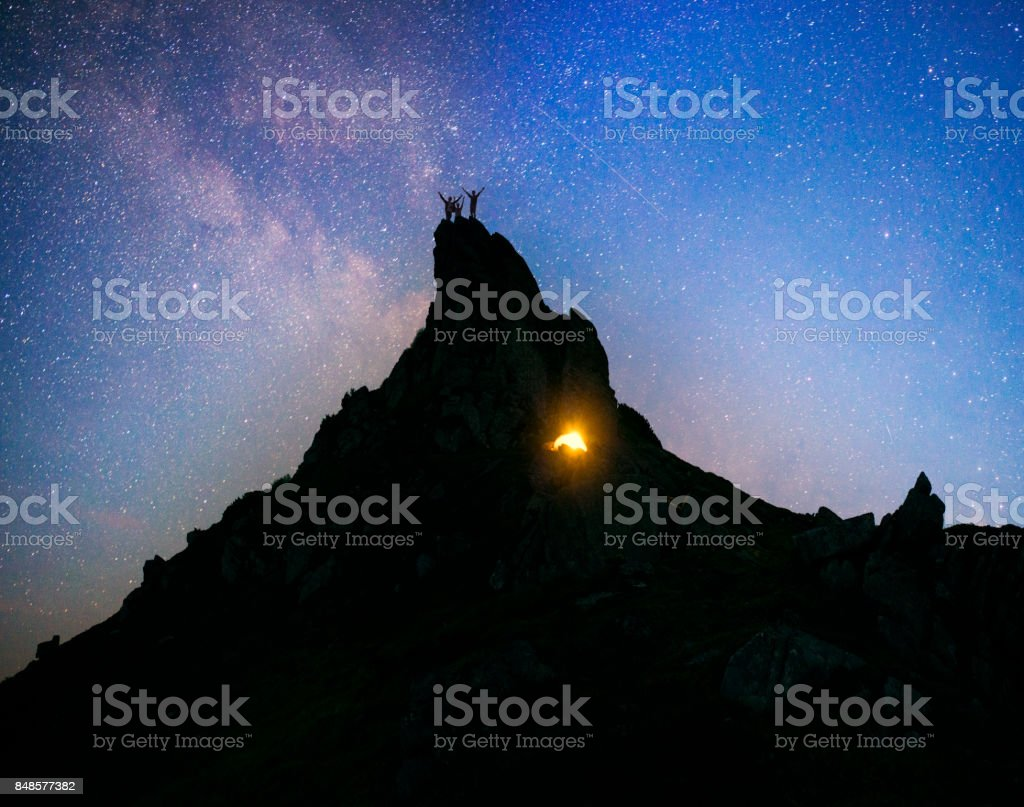 Climbing overnight on the rocks stock photo