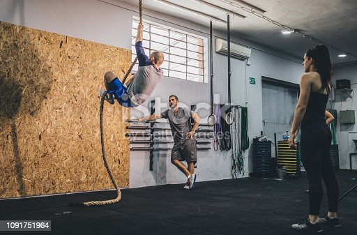904150892 istock photo Climbing rope at the gym 1091751964