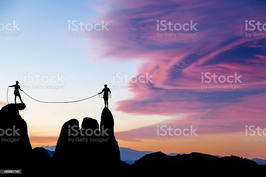 Climbing team on the edge. stock photo