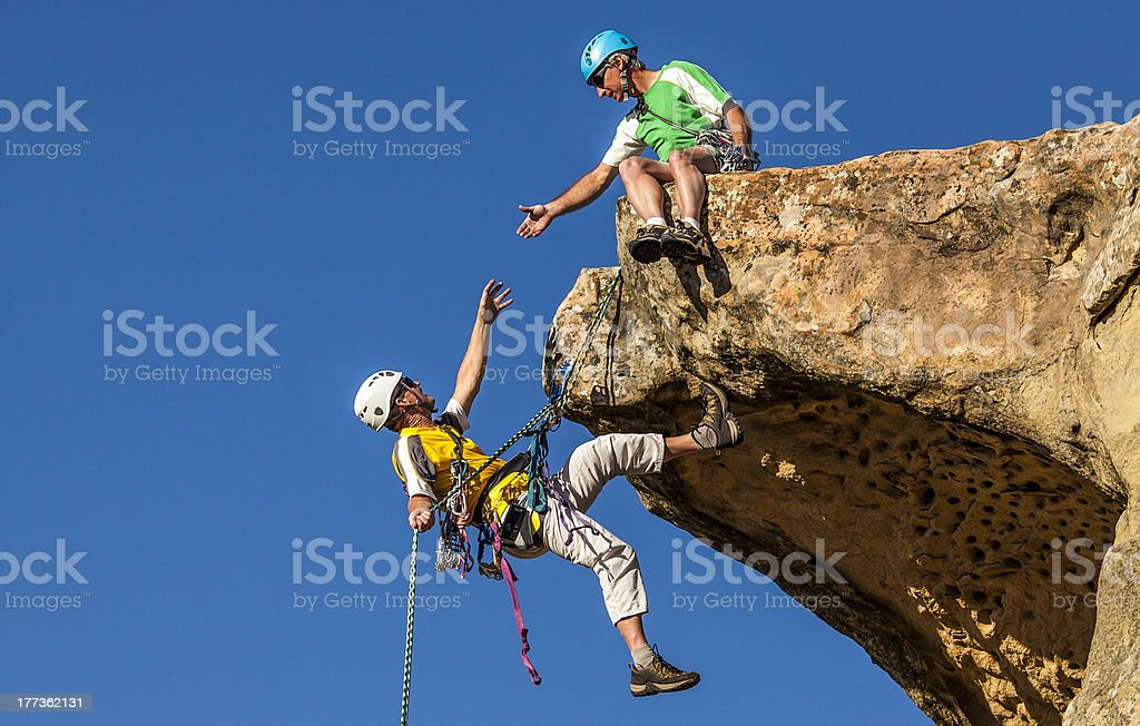 Climbing team struggles to the summit. royalty-free stock photo