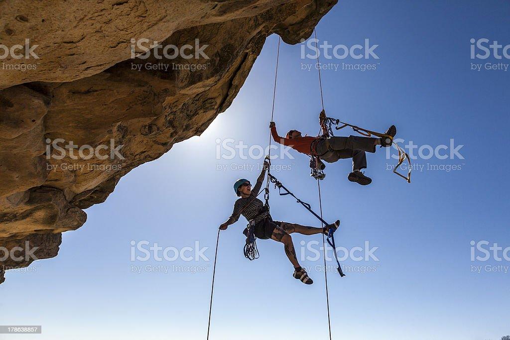 Climbing team struggles to the summit. stock photo