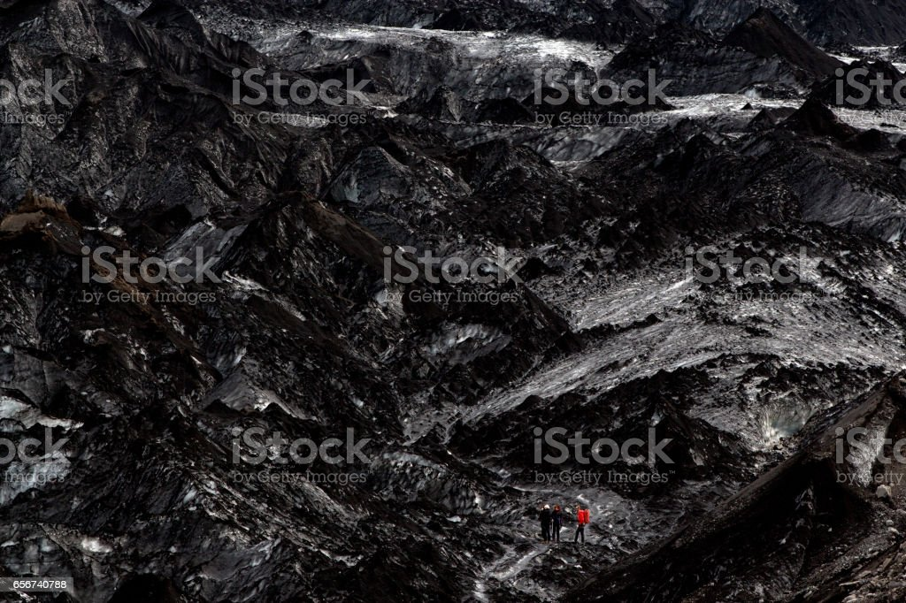 Climbing the ash coated glacier in Iceland stock photo