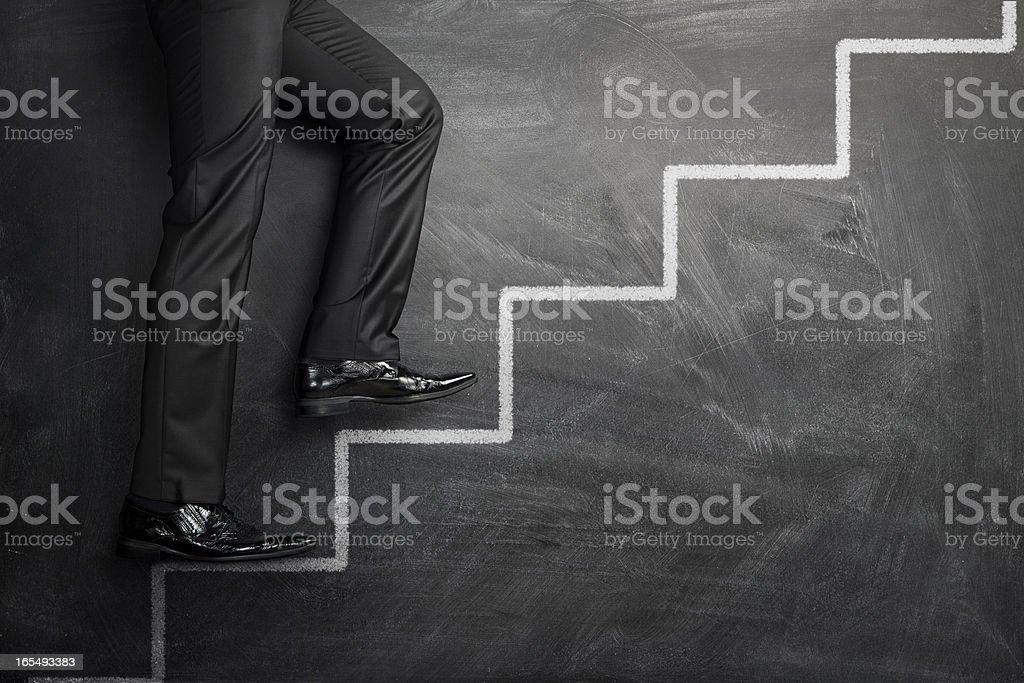 Subir las escaleras de la carrera foto de stock libre de derechos
