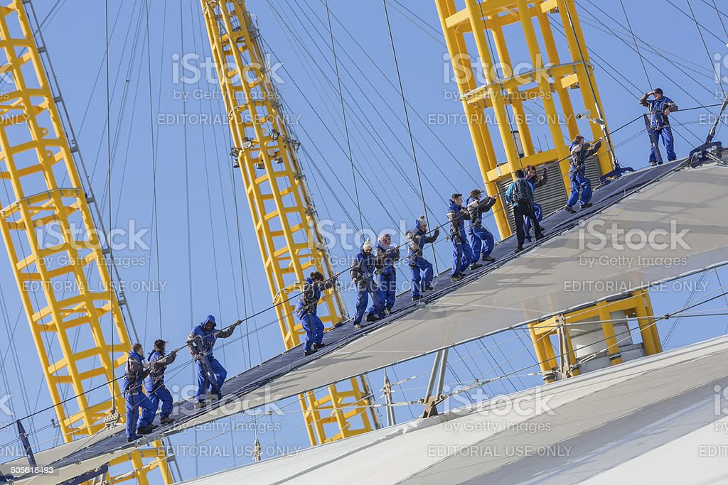 Climbing the Millennium Dome stock photo