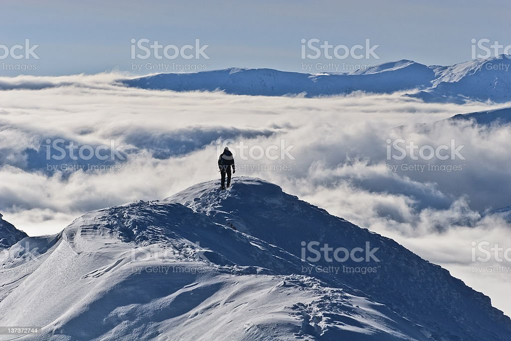 climbing the mountain in winter royalty-free stock photo