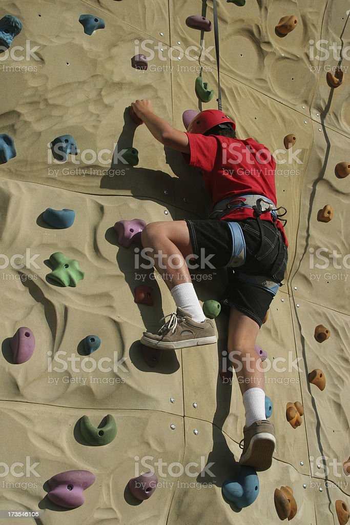 Climbing the wall royalty-free stock photo