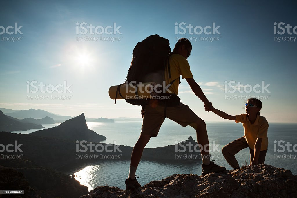 Climbing to a mountain stock photo