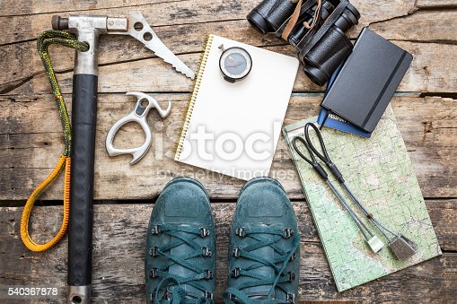 istock Climbing tools with boots on wood background 540367878
