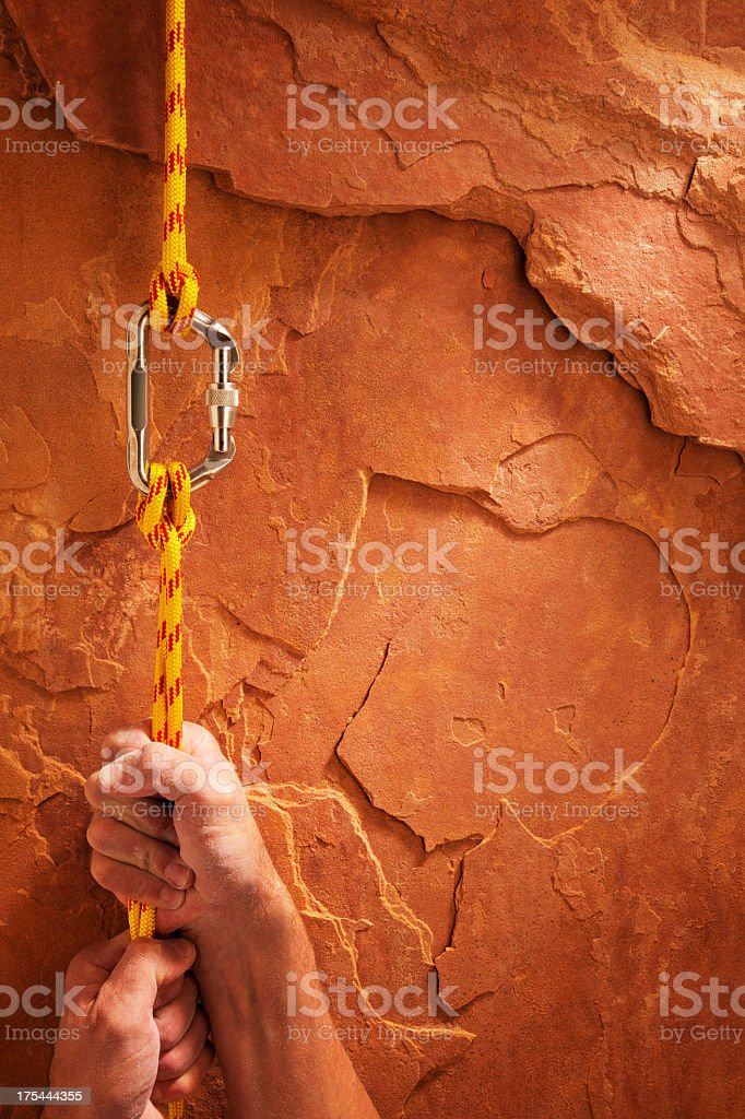 Climbing Up a Red Rock stock photo