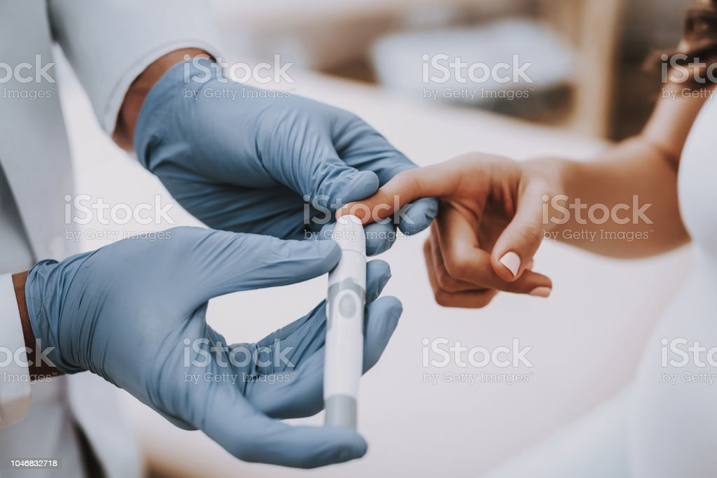 Clinic. Doctor Makes Blood. Test. Have Fun. Belly. Clinic. Doctor Makes Blood. Test. Have Fun. Childbirth. Belly. Fan. Consultation. Hospital. Pregnant Woman. Smiling. Clinic. Gynecologist. White Coat. Motherhood. Doctor. Ultrasound. Medical Advice. Abdomen Stock Photo