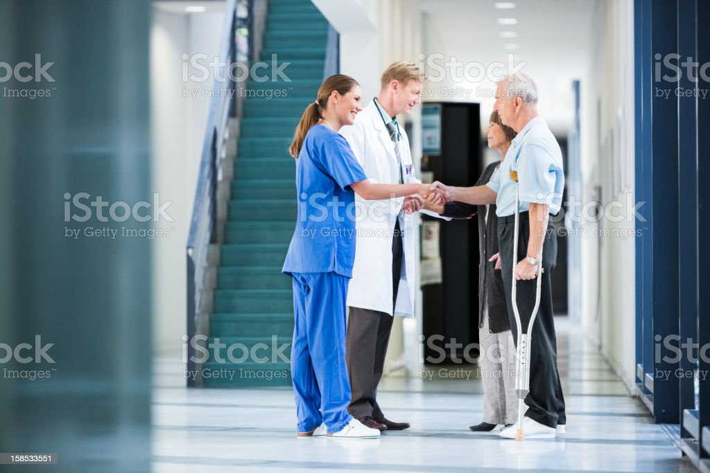 Clinic Staff Welcomes Patients royalty-free stock photo