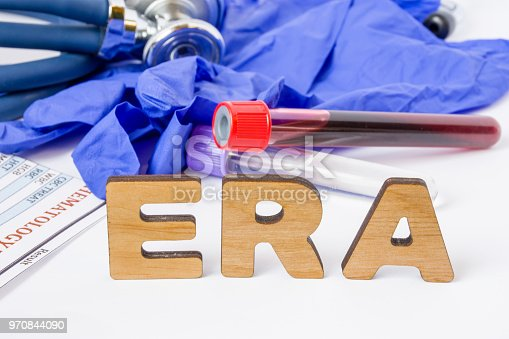 istock ERA Clinical laboratory medical acronym or abbreviation of estrogen receptor assay or test to find out if cancer cells have this receptor. Word ERA are near laboratory test tubes with blood sample 970844090