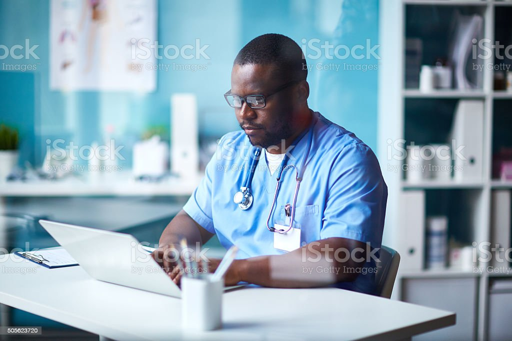 Clinician working in hospital stock photo