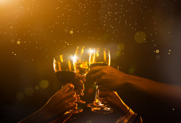 clink glasses at night party celebration friends group golden tone, hands holding wine for event festival. - gmail imagens e fotografias de stock