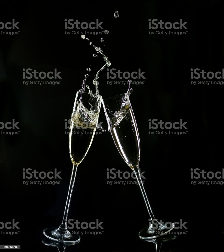 Clinking Champagne Glasses On Black Background stock photo