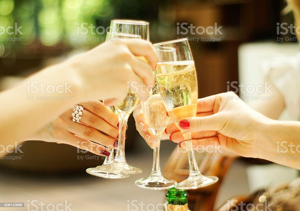 clinking glasses of champagne stock photo