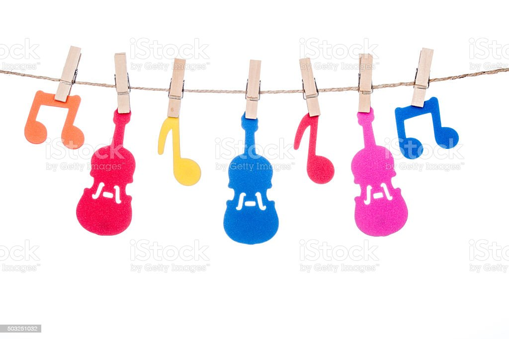 clip on a  twine , hanging colorful music symbol and Guitar stock photo
