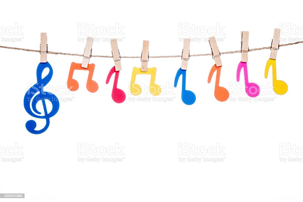 clip on a  twine , hanging colorful music symbol stock photo