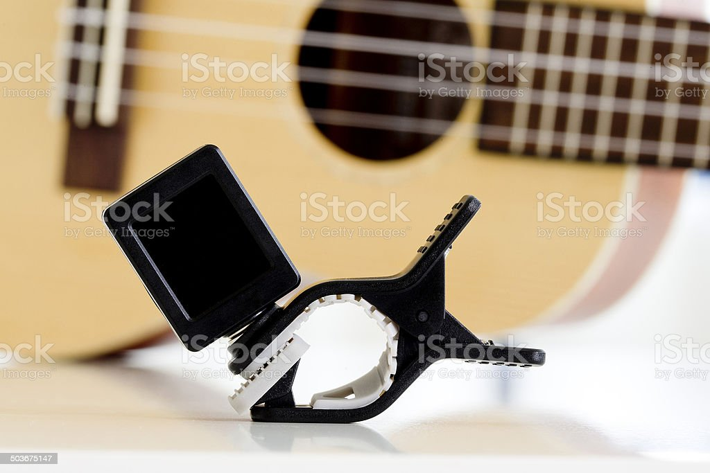 Clip tuner Equipment For tuning the ukulele guitar sound. stock photo