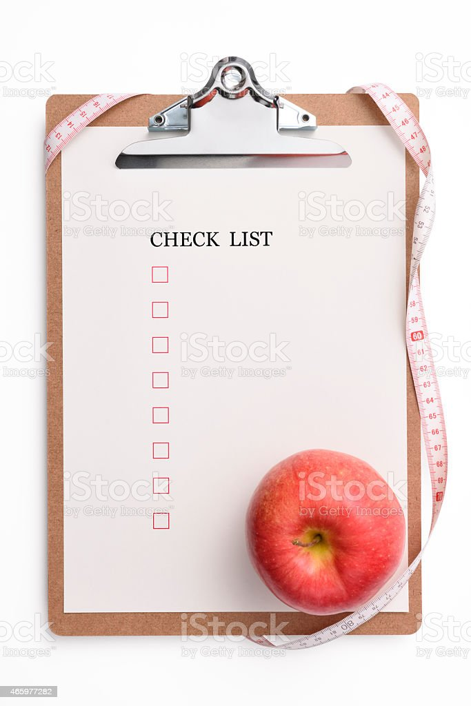 Clipboard and check list with red apple and measurement tape,...