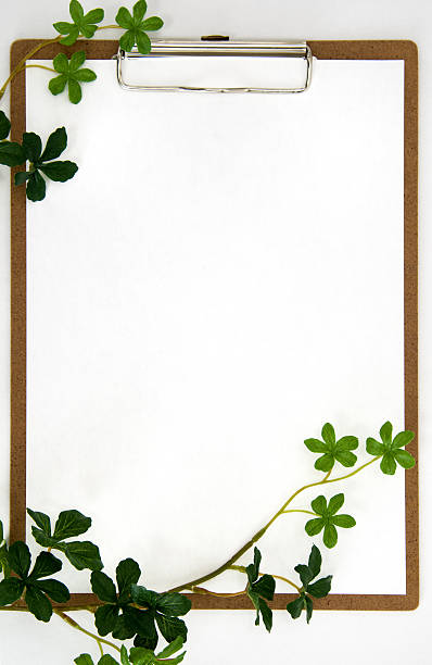 Clipboard and Plant leaf stock photo