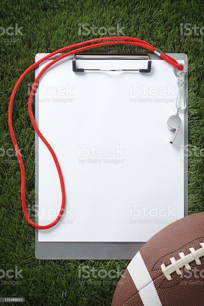 Clipboard on the Grass with Football stock photo