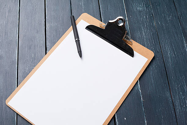 clipboard on wooden background stock photo