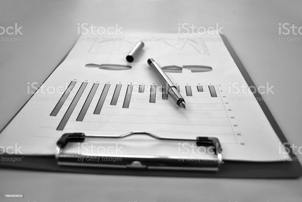 Clipboard with analytical graphs royalty-free stock photo