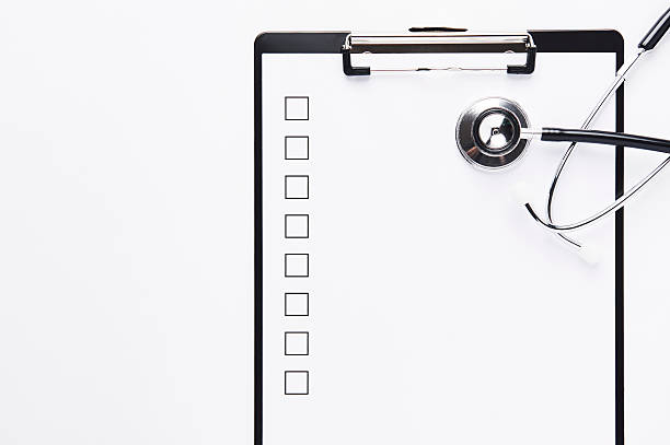 Clipboard with blank checklist and stethoscope stock photo