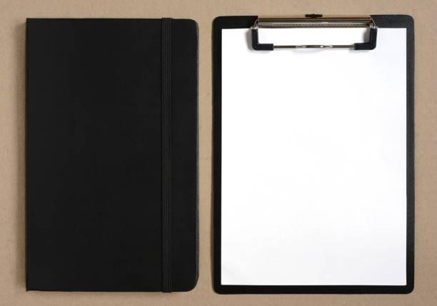clipboard with blank sheet of paper and black notebook - menüplanung vorlagen stock-fotos und bilder