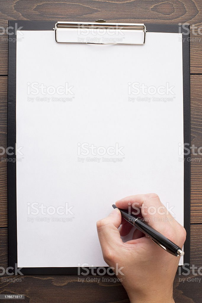 Clipboard with blank sheet of white paper and pen royalty-free stock photo