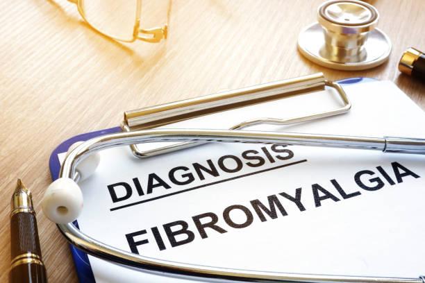 Clipboard with diagnosis fibromyalgia and pen. stock photo