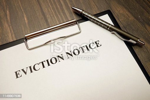 istock Clipboard with eviction notice and pen on desk 1149907536