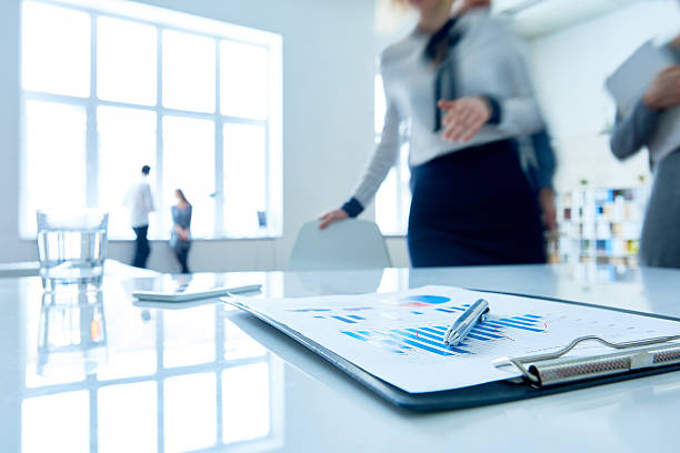 clipboard with financial statistics - market research stock photos and pictures