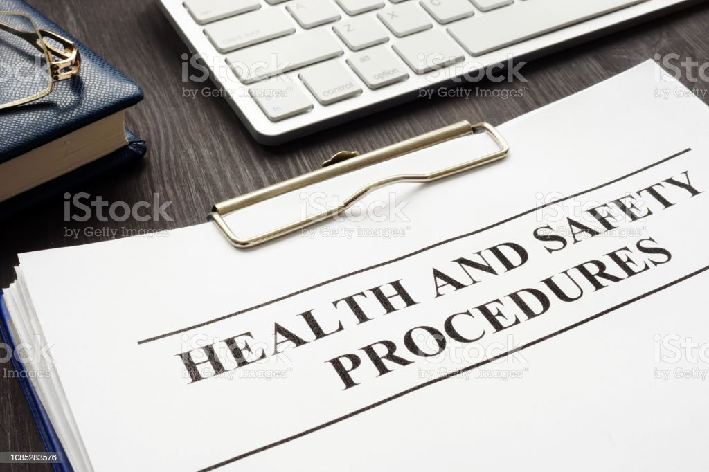 Clipboard with health and safety procedures on the table.