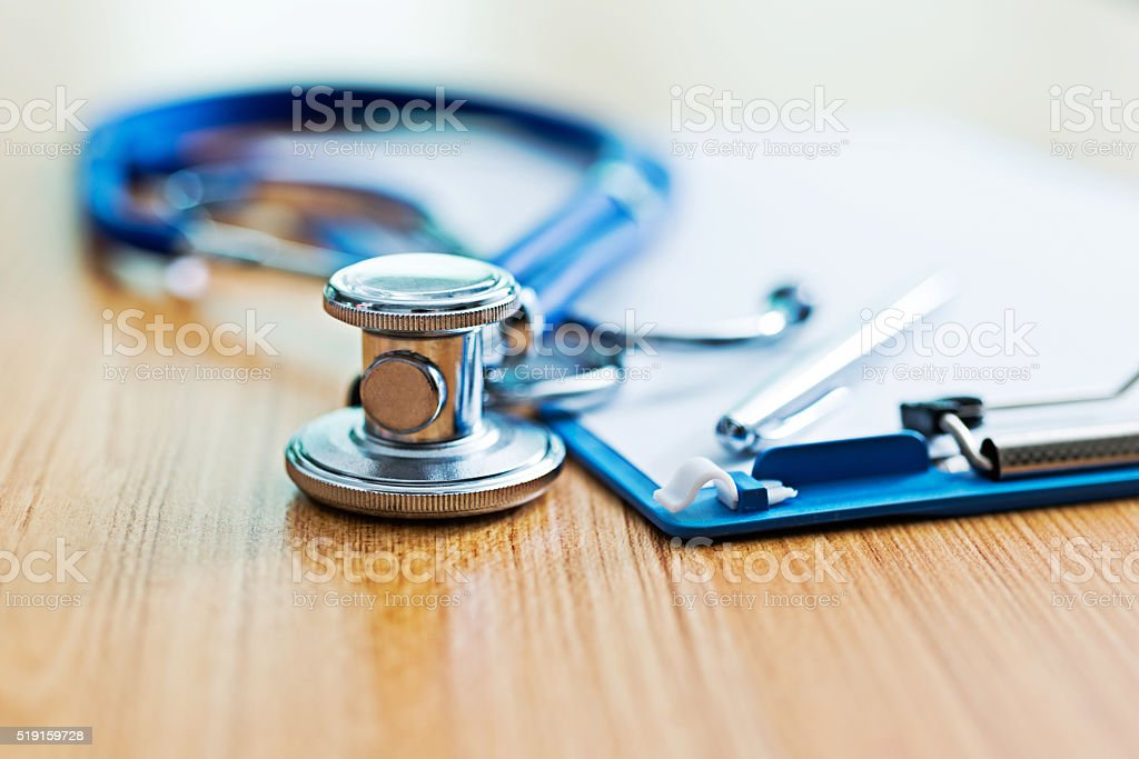 Clipboard with stethoscope and pen stock photo