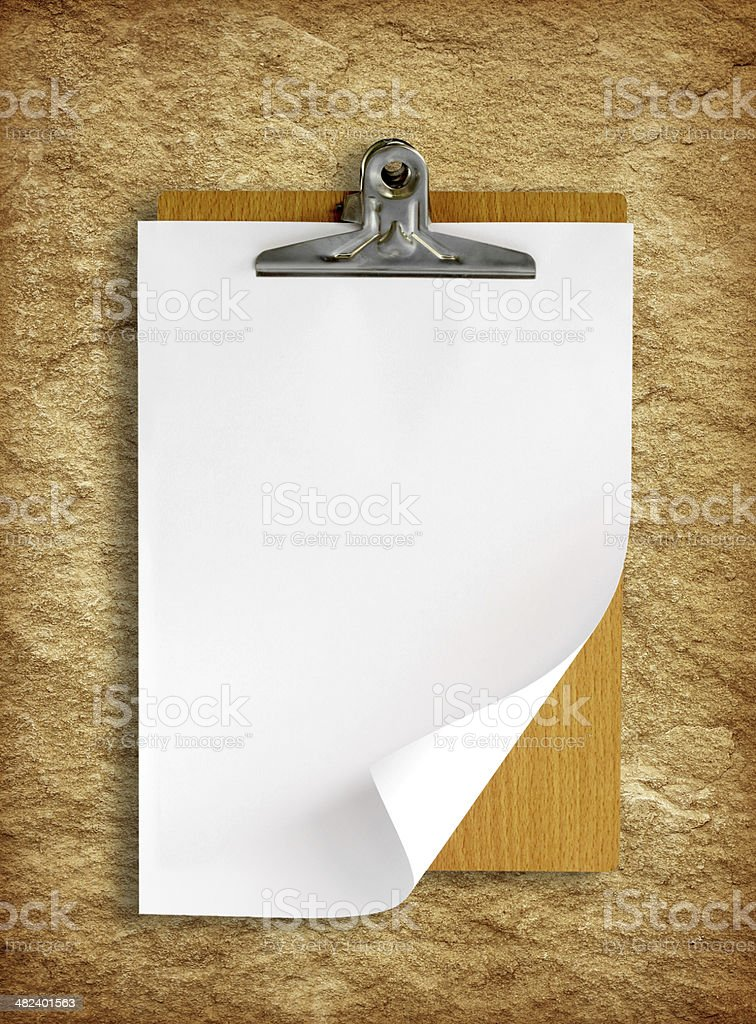 clipboard with white paper on stone background stock photo