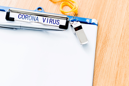 istock A clipboard with word coronavirus on desk 1215672903