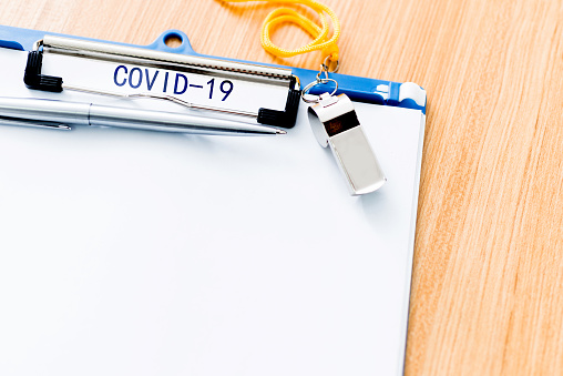 istock A clipboard with word COVID-19 on desk 1215672782