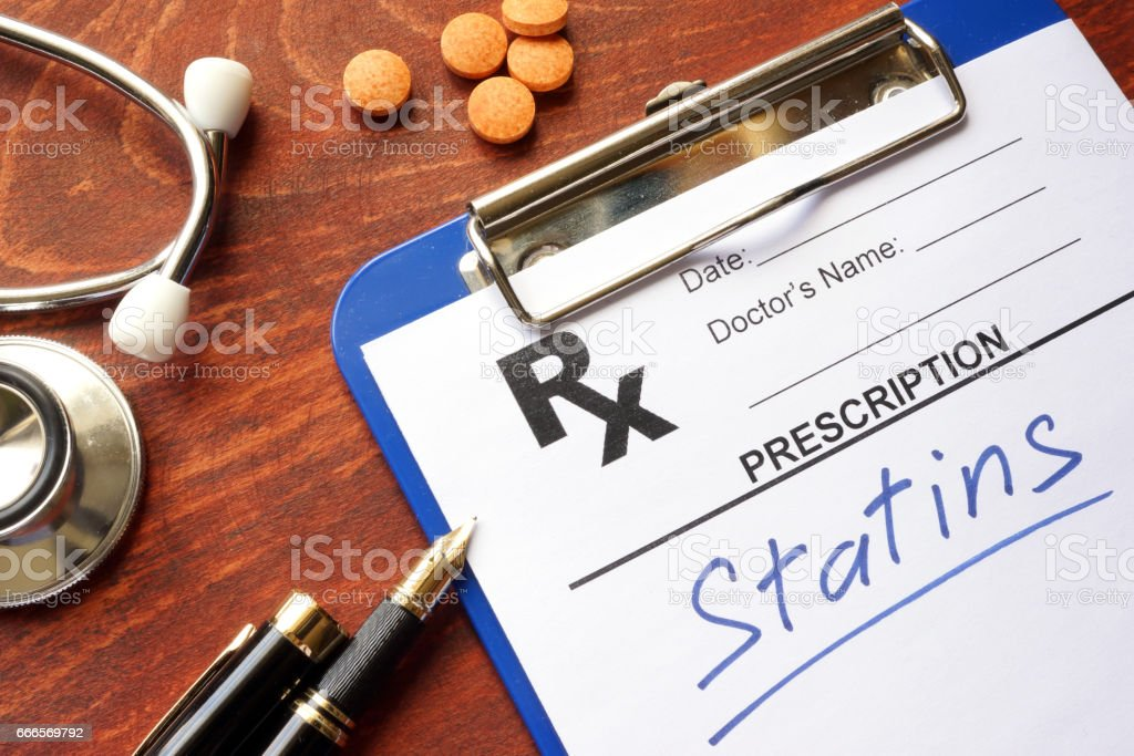 Clipboard with written prescription statins and stethoscope. stock photo
