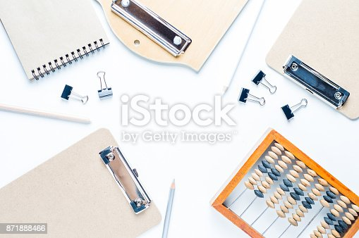 istock Clipboards and stationery on white background 871888466