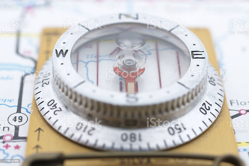 clip-on compass on map pointing south royalty-free stock photo