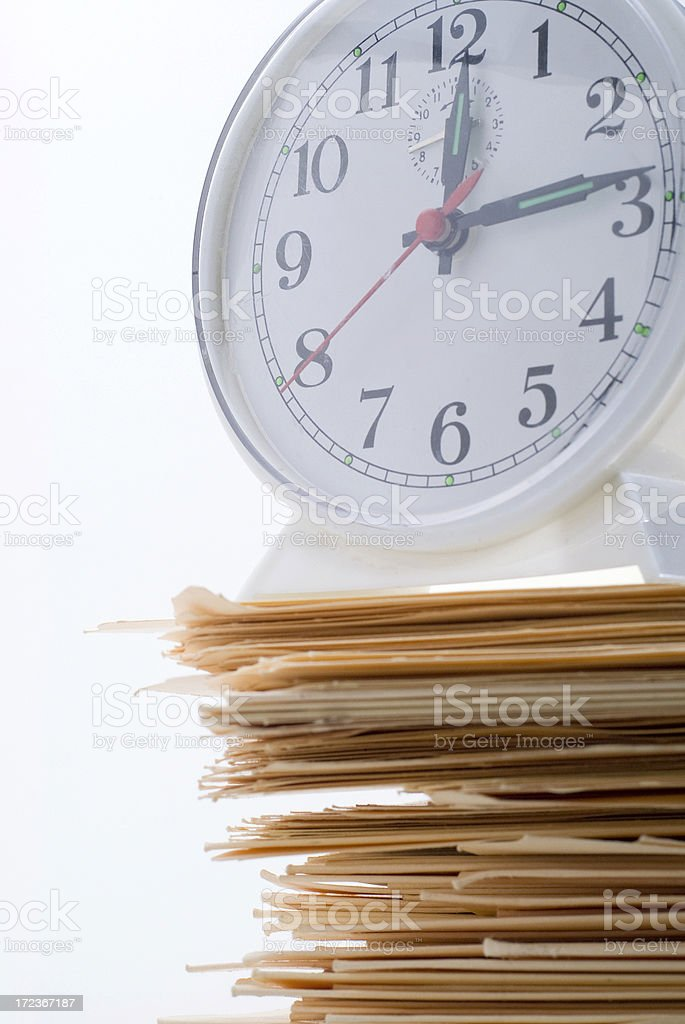 Clock And A Stacked Pile Of Files royalty-free stock photo